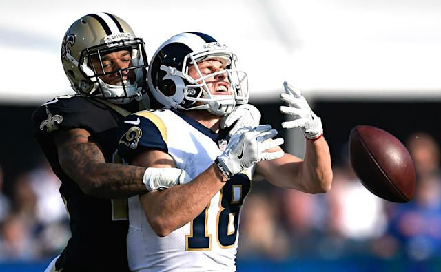 <p>New Orleans Saints cornerback P.J. Williams, left, breaks up a pass intended for Los Angeles Rams wide receiver Cooper Kupp (18) during the first half of an NFL football game Sunday, Nov. 26, 2017, in Los Angeles. (AP Photo/Kelvin Kuo) </p>