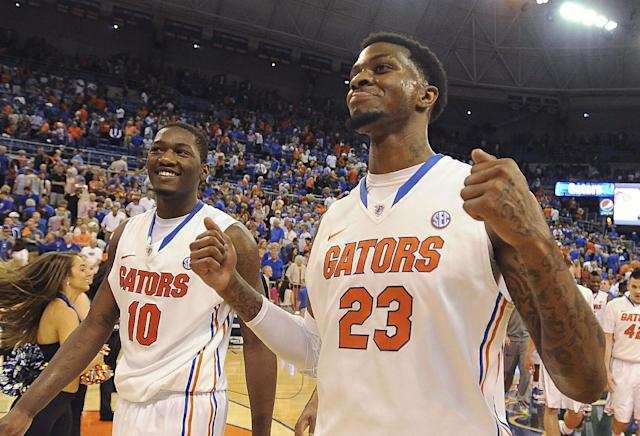 Florida's Chris Walker (23) and Dorian Finney-Smith (10) come off the court with smiles after Florida defeated LSU 79-61 in an NCAA college basketball game Saturday, March 1, 2014, in Gainesville, Fla. (AP Photo/Phil Sandlin)