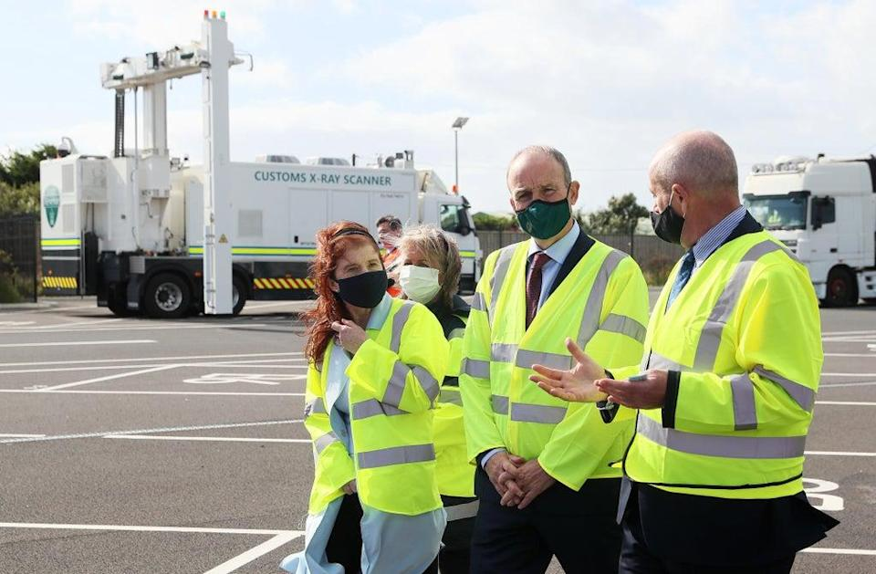 Taoiseach Micheal Martin, second right, at Rosslare Europort, Co Wexford (Brian Lawless/PA) (PA Wire)