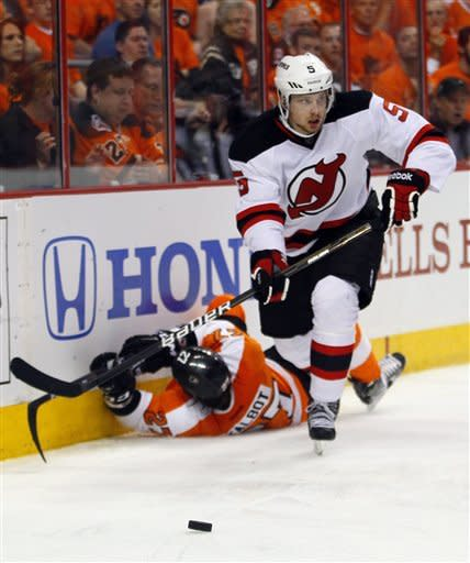 New Jersey Devils' Adam Larsson, right, leaves Philadelphia Flyers' Max Talbot down on the ice after a check as he goes after the puck during the second period in Game 2 of an NHL hockey Stanley Cup second-round playoff series, Tuesday, May 1, 2012, in Philadelphia. (AP Photo/Tom Mihalek)