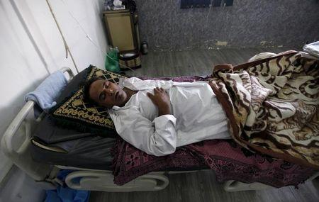 A patient suffering from cholera rests inside a hospital in Baghdad