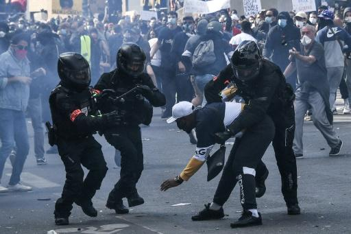 Violence broke out in Paris after officers stopped protesters trying to launch a march through the streets of the capital