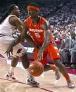 Syracuse's C.J. Fair (5) drives around Arkansas' Michael Qualls during the first half of an NCAA college basketball game in Fayetteville, Ark., Friday, Nov. 30, 2012. (AP Photo/Gareth Patterson)
