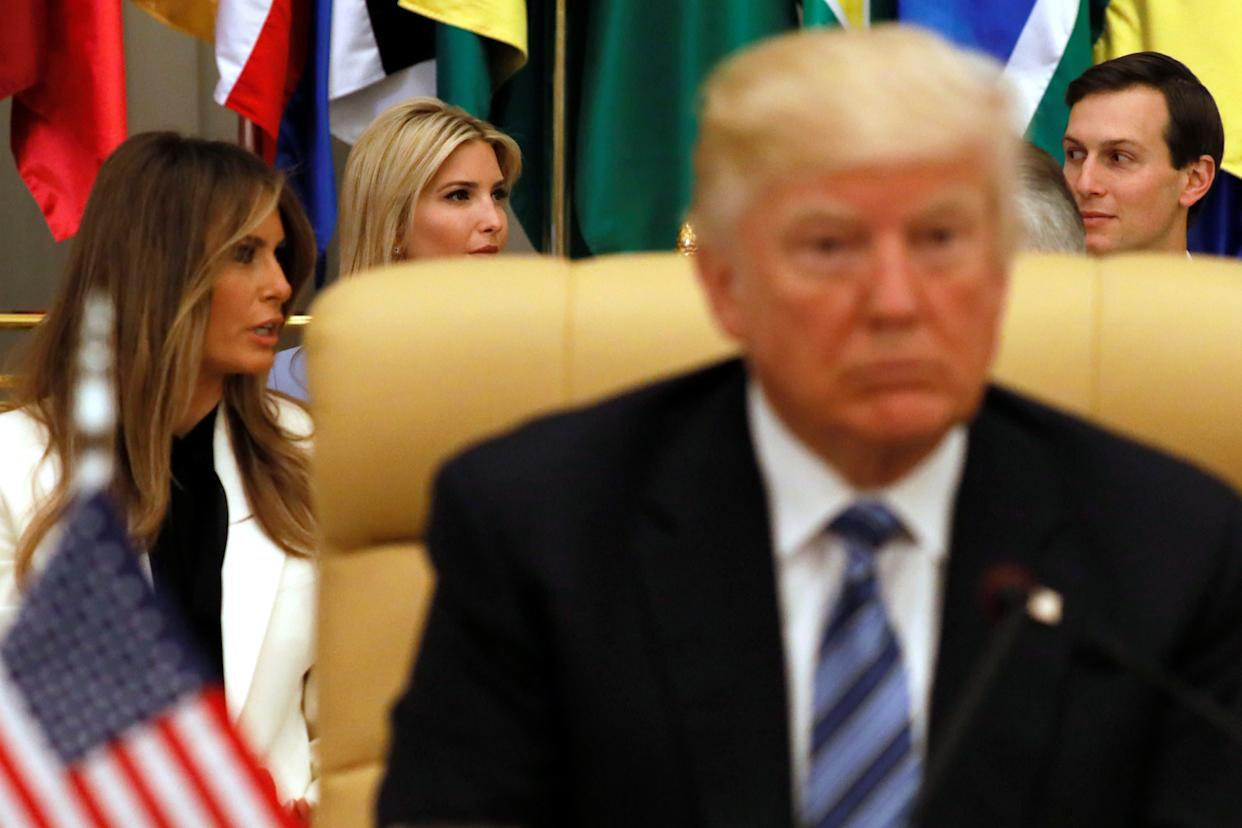 Melania Trump, Ivanka Trump and her husband, White House senior adviser Jared Kushner, sit behind the president shortly before he delivered his remarks to the Arab Islamic American Summit in Riyadh on May 21, 2017.