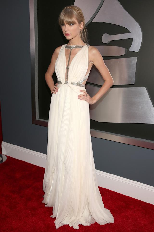 Taylor Swift looks ethereal in a J. Mendel white dress. Her plaited 'do makes her look more goddess-like.