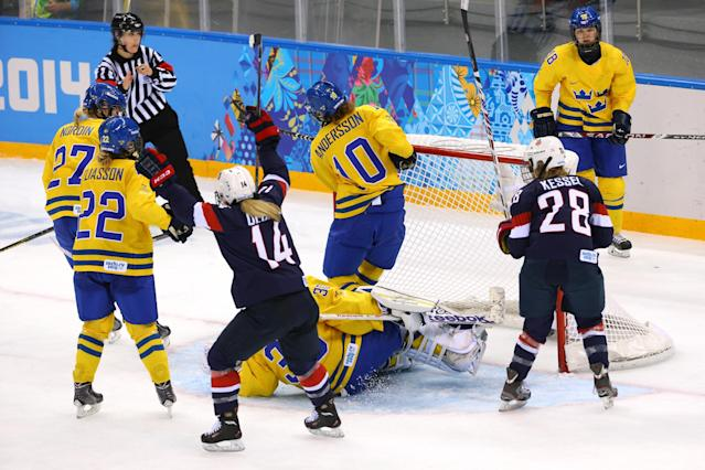 SOCHI, RUSSIA - FEBRUARY 17: Brianna Decker #14 of the United States celebrates after her goal in the third period against Kim Martin Hasson #30 of Sweden during the Women's Ice Hockey Playoffs Semifinal game on day ten of the Sochi 2014 Winter Olympics at Shayba Arena on February 17, 2014 in Sochi, Russia. (Photo by Doug Pensinger/Getty Images)