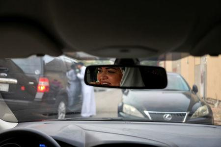 Dr Samira al-Ghamdi, 47, a practicing psychologist, drives around the side roads of a neighborhood as she prepares to hit the road on Sunday as a licensed driver, in Jeddah