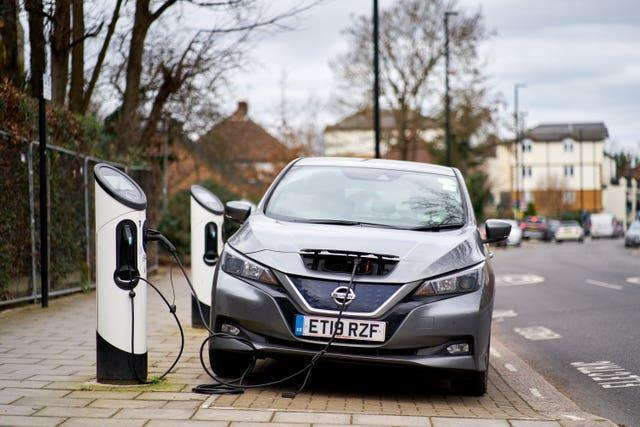 A Nissan Leaf electric car being charged in Isleworth, London (John Walton/PA)