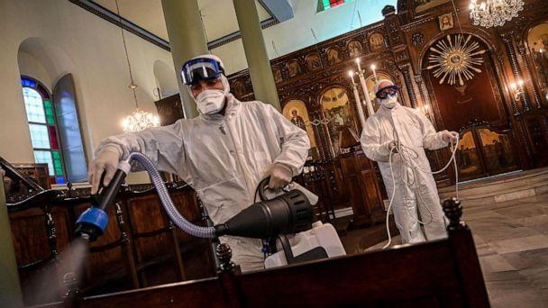 PHOTO: Workers of Istanbul's Metropolitan Municipality disinfect the Panagia Altimermer Orthodox Greek Church in Istanbul to prevent the spread of the COVID-19, caused by the novel coronavirus, March 15, 2020. (Ozan Kose/AFP/Getty Images)
