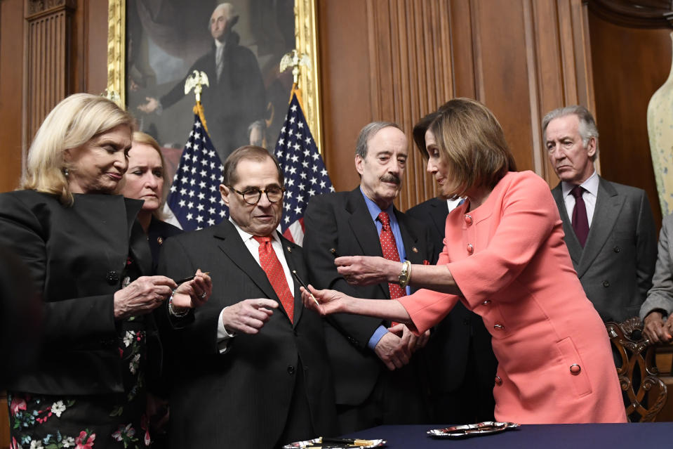 House Speaker Nancy Pelosi of Calif., second from right, gives pens to, from left, House Oversight and Government Reform Committee Chair Rep. Carolyn Maloney, D-N.Y., Rep. Sylvia Garcia, D-Texas, House Judiciary Committee Chairman Rep. Jerrold Nadler, D-N.Y., House Foreign Affairs Committee Chairman Rep. Eliot Engel, D-N.Y., and House Ways and Means Committee Chairman Rep. Richard Neal, D-Mass., after she signed the resolution to transmit the two articles of impeachment against President Donald Trump to the Senate for trial on Capitol Hill in Washington, Wednesday, Jan. 15, 2020. The two articles of impeachment against Trump are for abuse of power and obstruction of Congress. (AP Photo/Susan Walsh)
