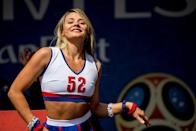 <p>A Russian cheerleader dances during the opening ceremony of the FIFA Fan Fest in Nizhny Novgorod on June 14, 2018, ahead of the Russia 2018 World Cup. (Photo by MARTIN BERNETTI / AFP) </p>