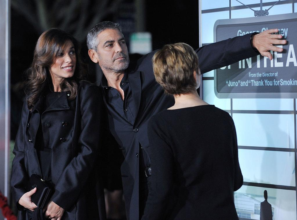 "<a href=""http://movies.yahoo.com/movie/contributor/1809679544"">Elisabetta Canalis</a>, <a href=""http://movies.yahoo.com/movie/contributor/1800019715"">George Clooney</a> and Nina Warren at the Los Angeles premiere of <a href=""http://movies.yahoo.com/movie/1810062520/info"">Up in the Air</a> - 11/30/2009"
