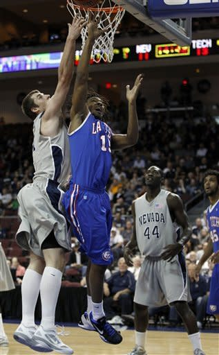 Louisiana Tech guard Cordarius Johnson (15) tried to score while being defended by Nevada forward Olek Czyz (31) during their NCAA college basketball game in the Western Athletic Conference tournament Friday, March 9, 2012, at The Orleans Arena in Las Vegas