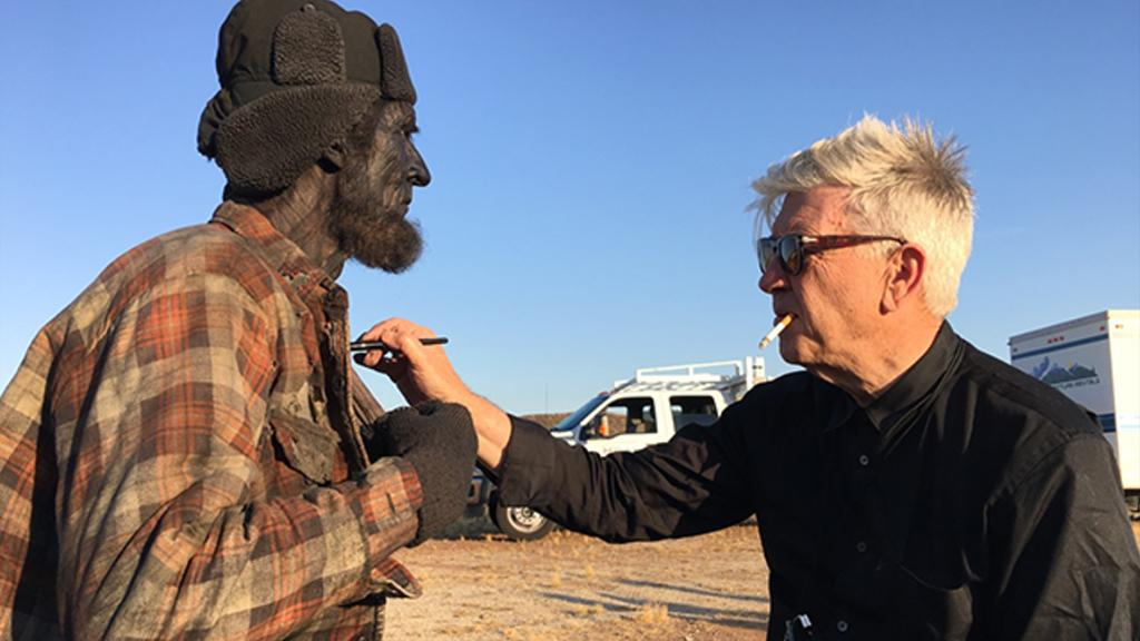 <p>David Lynch (right) puts some finishing touches on the Woodsman (Robert Broski).<br />(Photo: Showtime/Paramount/CBS Home Entertainment) </p>
