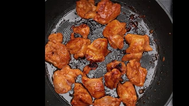Grilling chicken in a frying pan