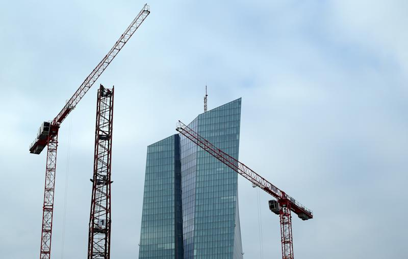 Specialists work on a crane in front of the European Central Bank (ECB) in Frankfurt