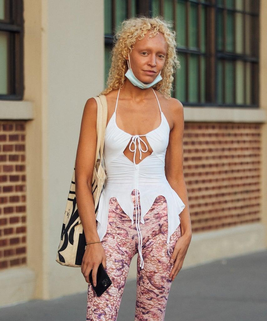 NEW YORK, NEW YORK – SEPTEMBER 07: Olive Perry wears a white top, pink printed pants, and white heels outside the Collina Strada show on September 07, 2021 in New York City. (Photo by Melodie Jeng/Getty Images)