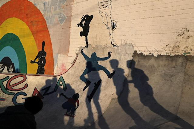 Members of Gaza Skating Team cast shadows as they practice their rollerblading and skating skills at the seaport of Gaza City March 8, 2019. Picture taken March 8, 2019. REUTERS/Mohammed Salem