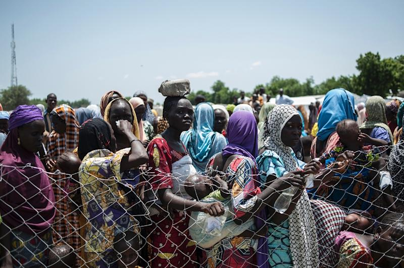 women and children queue to enter one of the Unicef nutrition clinics in Muna informal settlement, which now houses more than 16,000 IDPs (internaly displaced people) in the outskirts of Maiduguri the capital of Borno State, northeastern Nigeria