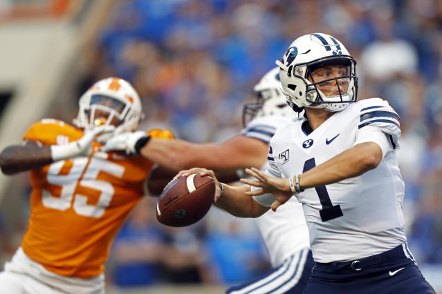 Brigham Young quarterback Zach Wilson (1) throws to a receiver in the first half of an NCAA college football game against Tennessee Saturday, Sept. 7, 2019, in Knoxville, Tenn. (AP Photo/Wade Payne)