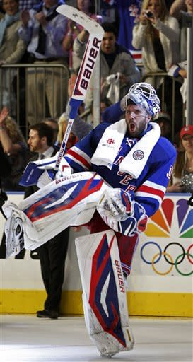 New York Rangers goalie Henrik Lundqvist celebrates after defeating the Washington Capitals in Game 7 of their second-round NHL hockey Stanley Cup playoff series at Madison Square Garden in New York, Saturday, May 12, 2012. The Rangers won 2-1. (AP Photo/Kathy Willens)