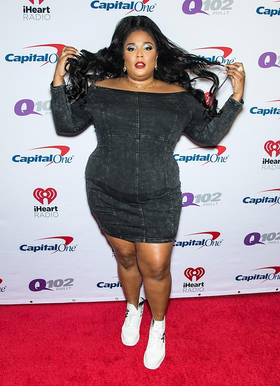 Lizzo also kept it cute and fun at the 2019 Jingle Ball in a dark denim mini-dress. Why wear heels when boots are available? (Also, this makeup deserves a standing ovation.)