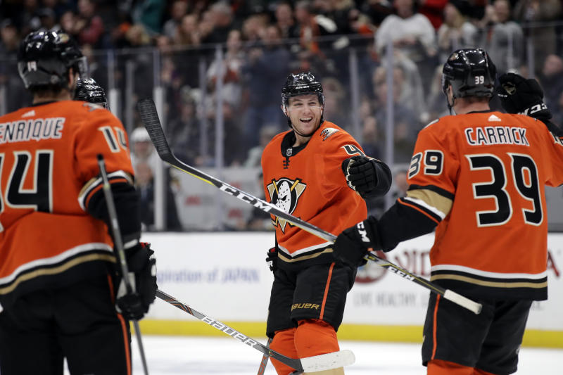 Anaheim Ducks' Cam Fowler, center, celebrates his goal with Adam Henrique, left, and Sam Carrick (39) during the second period of an NHL hockey game against the Vegas Golden Knights on Friday, Dec. 27, 2019, in Anaheim, Calif. (AP Photo/Marcio Jose Sanchez)