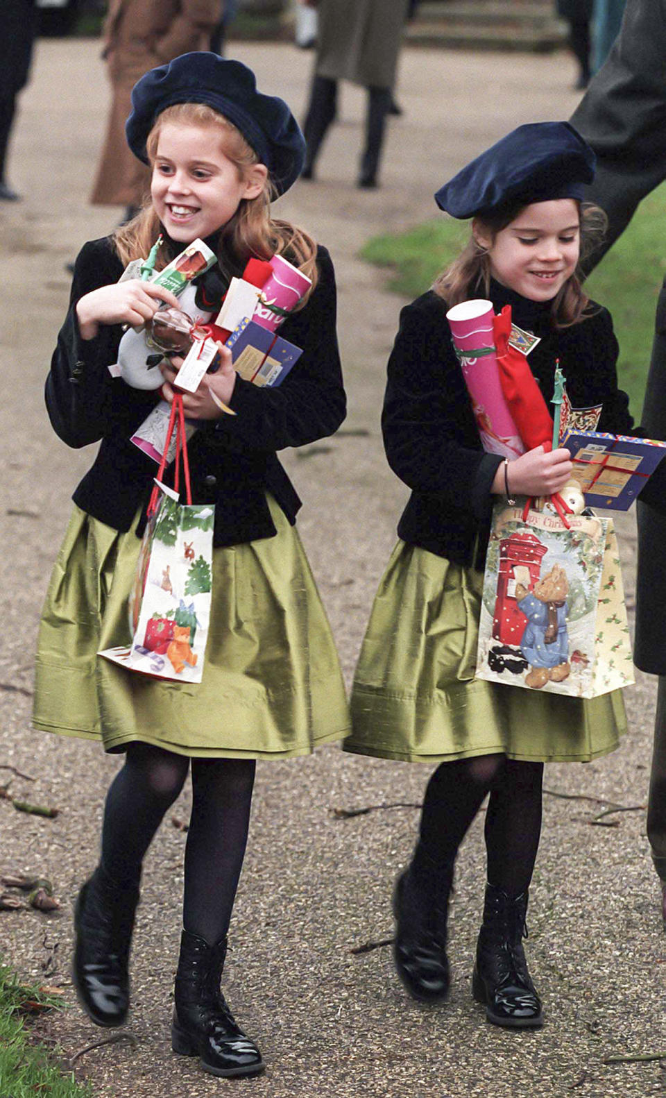 Princess Beatrice and Princess Eugenie couldn't hold in their excitement in 1997 when they received bundles of gifts from royal fans gathered outside the church. Photo: Getty Images