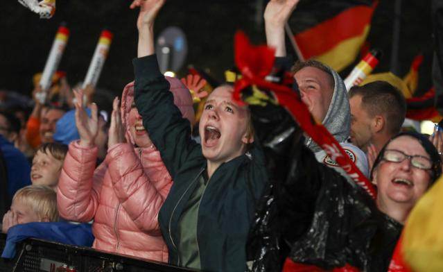 Soccer Football - World Cup - Group F - Germany vs Sweden - Berlin, Germany - June 23, 2018 Germany soccer fans react as they watch the match at public viewing area at Brandenburg Gate. REUTERS/Christian Mang