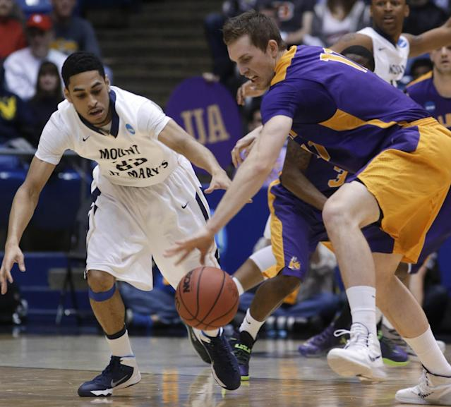 Mount St. Mary's guard Julian Norfleet, left, and Albany forward Luke Devlin chase a loose ball in the first half of a first-round game of the NCAA college basketball tournament, Tuesday, March 18, 2014, in Dayton, Ohio. (AP Photo/Al Behrman)