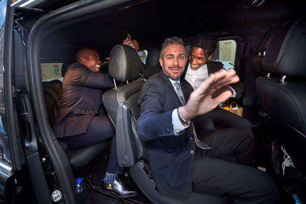 PHOTO: Rapper ASAP Rocky, right, celebrates while leaving the district court in his car after the third day of the rapper's trial over a June street brawl on Friday, Aug. 2, 2019 in Stockholm. (Fredrik Persson/AFP/Getty Images)