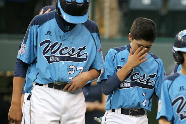 CORRECTS SCORE TO 7-5, NOT 7-6 - Las Vegas' Brennan Holligan (27), and Josiah Cromwick (7) walk off the field after a 7-5 loss to Chicago in the United States Championship game at the Little League World Series tournament in South Williamsport, Pa., Saturday, Aug. 23, 2014. (AP Photo/Gene J. Puskar