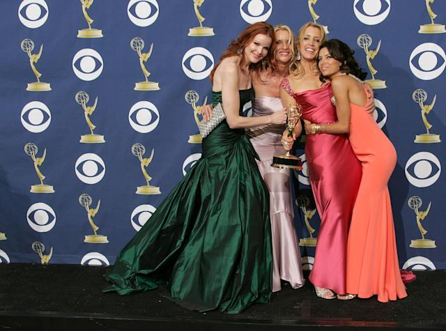 The women of <em>Desperate Housewives</em> pose in the press room at the 57th Annual Emmy Awards in 2005. [Photo: Getty Images]