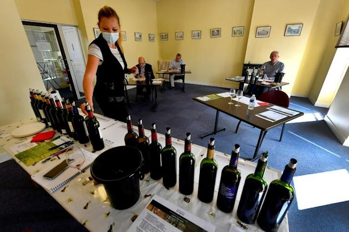 There were waiters to pour the wine at individual stations, but no producers to extoll the virtues of the produce (AFP Photo/GEORGES GOBET)
