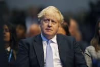 Britain's Prime Minister Boris Johnson watches as Chancellor of the Exchequer Rishi Sunak speaks during the Conservative Party Conference in Manchester, England, Monday, Oct. 4, 2021. (Peter Byrne/PA via AP)