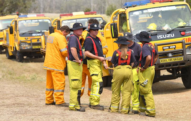 Rural firefighters are seen preparing to fight fires at Spicers Gap, south west of Brisbane, Wednesday, November 13, 2019. A number of homes have been destroyed by bushfires in New South Wales and Queensland. (AAP Image/Darren England)