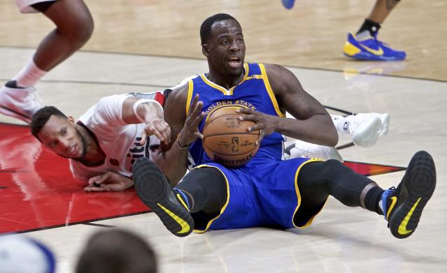 Golden State Warriors forward Draymond Green, right, and Portland Trail Blazers guard Evan Turner dive for a loose ball during the second half of Game 3 of an NBA basketball first-round playoff series Saturday, April 22, 2017, in Portland, Ore. The Warriors won 119-113. (AP Photo/Craig Mitchelldyer)
