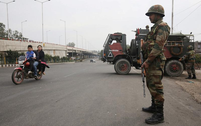 An Indian solider stands guard in Jammu, the winter capital of the Indian-controlled state of Jammu and Kashmir. - REUTERS