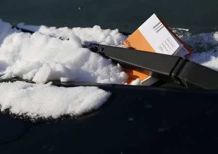 A parking ticket issued by the NYPD is seen on a car in the Queens borough of New York January 7, 2015. REUTERS/Shannon Stapleton