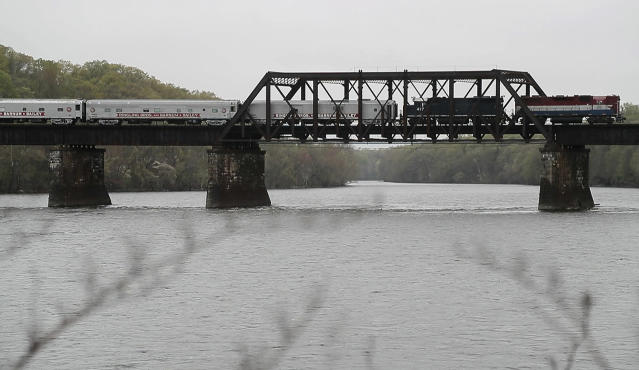 <p>The Ringling Bros. and Barnum & Bailey Circus red unit train passes over a bridge Monday, May 1, 2017, in Enfield, Conn. as it makes its way to Providence, R.I. The train, which is about a mile long, carries the crew, performers and equipment to a different city each week. (Photo: Julie Jacobson/AP) </p>