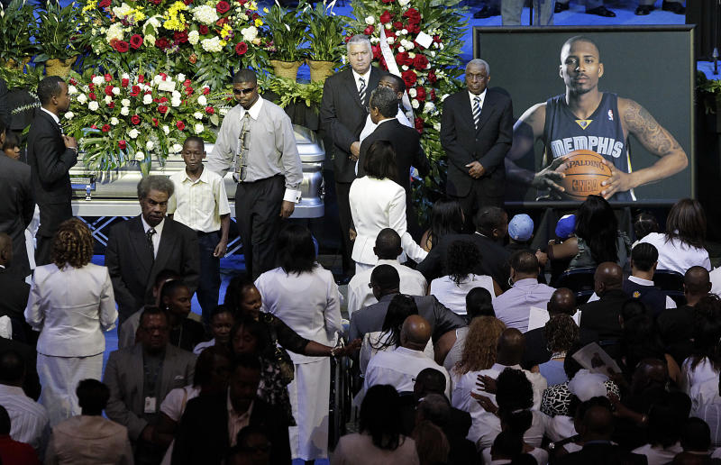 Friends and family of slain NBA basketball player Lorenzen Wright grieve at the casket of Wright.