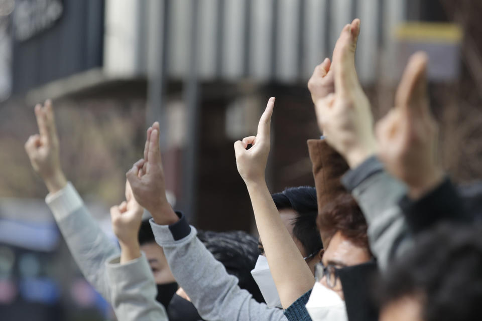 Youths from Asian countries participate during a press conference supporting Myanmar's democracy outside of the Office of the United Nations High Commissioner for Human Rights, in Seoul, South Korea, Sunday, Feb. 21, 2021. (AP Photo/Lee Jin-man)
