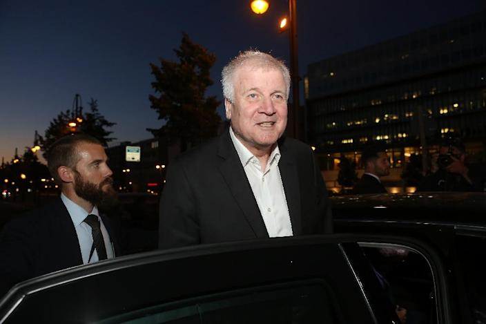 In a pact both sides hailed as a victory, Merkel and Seehofer agreed to tighten border controls and set up closed holding centres to allow the speedy processing of asylum seekers and the repatriations of those who are rejected (AFP Photo/Adam BERRY)