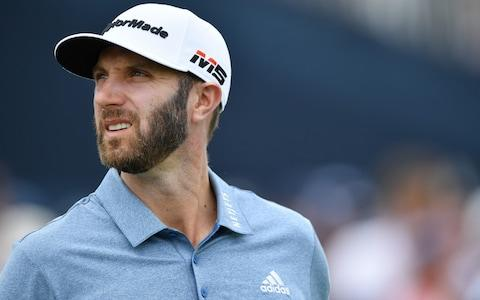 Dustin Johnson stares into the middle-distance on the 1st - Credit: Getty Images North America