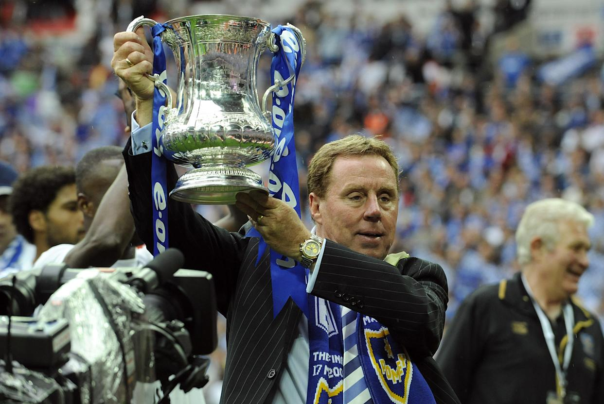 Portsmouth manager Harry Redknapp celebrates with the FA Cup.   (Photo by Rebecca Naden - PA Images/PA Images via Getty Images)