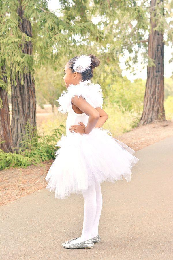 """<p>It may not look like it, but this stunning costume straight out of Swan Lake doesn't take much more than white tulle, a feather boa and a bit of needle and thread before it's ready for its big debut.</p><p><strong>Get the tutorial at <a href=""""https://apumpkinandaprincess.com/diy-white-swan-costume/"""" rel=""""nofollow noopener"""" target=""""_blank"""" data-ylk=""""slk:a Pumpkin and a Princess"""" class=""""link rapid-noclick-resp"""">a Pumpkin and a Princess</a>.</strong></p><p><a class=""""link rapid-noclick-resp"""" href=""""https://go.redirectingat.com?id=74968X1596630&url=https%3A%2F%2Fwww.walmart.com%2Fip%2FBalsaCircle-6-feet-Large-Feather-Boa-White%2F219871663&sref=https%3A%2F%2Fwww.countryliving.com%2Fdiy-crafts%2Fg23785711%2Flast-minute-halloween-costumes%2F"""" rel=""""nofollow noopener"""" target=""""_blank"""" data-ylk=""""slk:SHOP FEATHER BOAS"""">SHOP FEATHER BOAS</a></p>"""