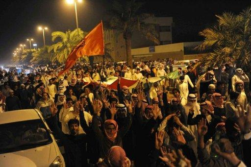 Kuwaiti opposition supporters march on a major road in the Sabah al-Nasser district of Kuwait City on December 3