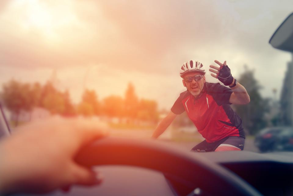 Cyclist gesturing at driver. Source: Getty Images