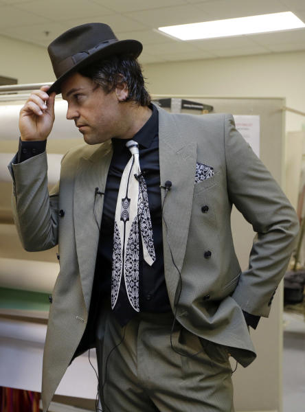 "Mike Piazza, former MLB baseball player, strikes a pose as he is fitted for his costume for his role in ""Slaughter on Tenth Avenue"" at the Miami City Ballet, Tuesday, April 16, 2013, in Miami Beach, Fla. Piazza will play a gangster in the ballet on May 3. He will say a few lines and then watch the rest of the performance from a seat onstage.  Piazza says his turn with the troupe is his gift to his 6-year-old daughter, a student at Miami City Ballet School. (AP Photo/Lynne Sladky)"