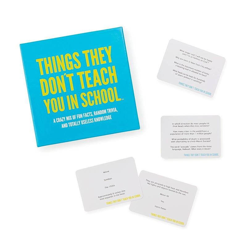 """In which direction do most people tilt their heads when they kiss someone?"" Imagine a chemistry teacher asking that. Doesn't happen, but it's important! Get it for $26.46 at <a href=""https://www.uncommongoods.com/product/things-they-dont-teach-you-in-school-game"" target=""_blank"" rel=""noopener noreferrer"">Uncommon Goods</a>."